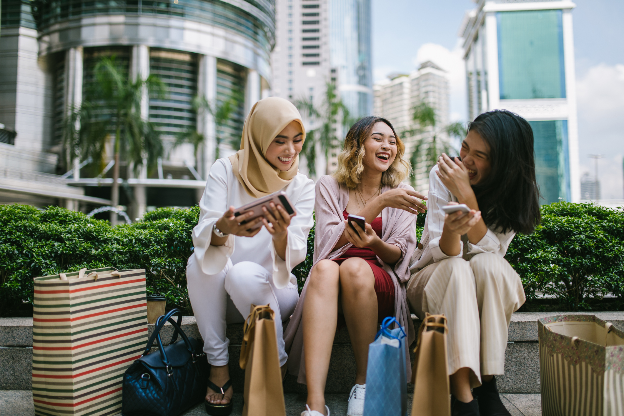 Multi-ethnic women setting and sharing phone messages